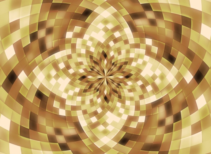 Image of varying tones of gold in a kaleidoscope
